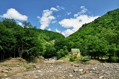 Blurred banks of a mountain river Stock Photos