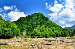 Blurred banks of a mountain river Stock Image