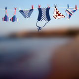Blurred beach and swimwear. Background for text with blurred beach and swimwear Stock Image