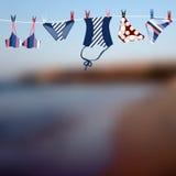 Blurred beach and swimwear Stock Image
