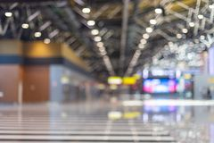Blurred beautiful bokeh background: blurred airport departure hall stock photo