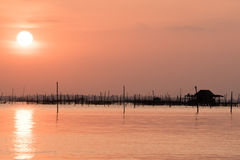 Blurred beautiful sunset above the sea in thailand. Silhouette of fish farms at sunset Stock Images