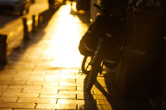 Blurred bicycle on the road in warm sunny light Stock Photos