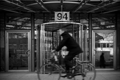 Blurred biker in front of a building Royalty Free Stock Photo