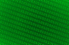 Blurred binary code background. A green background with rows of blurred binary code Stock Photography