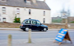 Blurred black cab in Inverness. An image of a Black Cab, usually seen in London,  working out of Inverness Royalty Free Stock Photos