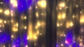 Blurred blinking light bulbs garlands. As an abstract holiday background for the video. Seamless loop. stock footage