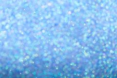 Blurred blue background with circle sparkling lights. Shiny brilliant glittery bokeh of christmas garland. Dark multicolored royalty free stock photo