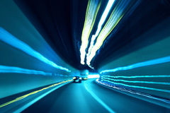 Blurred blue colored tunnel high speed car driving Stock Photo