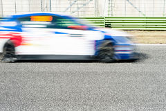 Blurred blue and red car racing on track Royalty Free Stock Photography