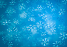 Blurred blue Snowflakes. On blue background Royalty Free Stock Image
