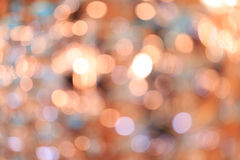 Blurred bokeh background. Holiday blurred bokeh background. Christmas background. Horizontal. Orange tone with blue and lilac Royalty Free Stock Photography