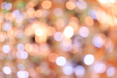Blurred bokeh background. Holiday blurred bokeh background. Christmas background. Horizontal. Warm beige tone with light lilac and green Stock Photos