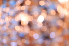 Blurred bokeh background. Holiday blurred bokeh background. Christmas background. Horizontal. Warm tone with orange, blue and lilac Stock Photography