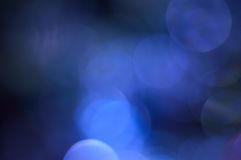 Blurred, bokeh blue lights background. Abstract sparkles Royalty Free Stock Photo