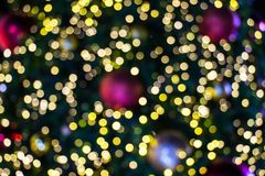 Blurred bokeh of Christmas light background. Close up decoration stock image