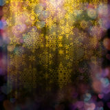 Blurred bokeh of Christmas lights. EPS 10. Magic orange holiday abstract glitter background with blinking stars and falling snowflakes. Blurred bokeh of Royalty Free Stock Images
