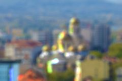 Blurred bokeh city buildings background. S Stock Images