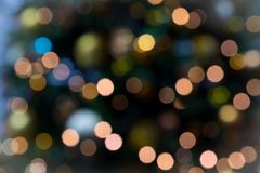 Blurred and bokeh image of Decorated Christmas tree on black bac Stock Photos