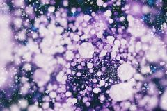 Happy lights to brighten up the dark days of winter, or bring fun to long summer nights. Blurred bokeh christmas background with snowflakes . Awesome winter royalty free stock photo