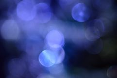 Blurred, bokeh lights background. Abstract sparkles Stock Images