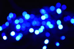 Blurred bokeh lights background. Blue and white blurred bokeh lights background Stock Images