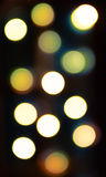 Blurred bokeh lights background in golden tones Royalty Free Stock Photography
