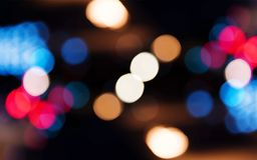 Blurred bokeh lights night time wallpaper Stock Photography