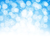 Blurred bokeh nature background with snow flakes Royalty Free Stock Image
