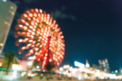 Blurred bokeh night harbor lights background with ferris wheel Royalty Free Stock Photos