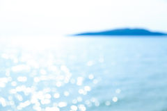 Blurred Bokeh of Reflection in Blue Sea. Bokeh of Glittering Reflective Light in Blue Sea Stock Images
