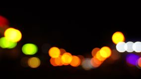 Traffic on the road at night in a big city, blurred bokeh stock footage