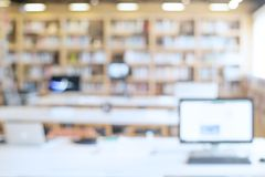 Blurred bookshelf in library room. For your background design Stock Photography