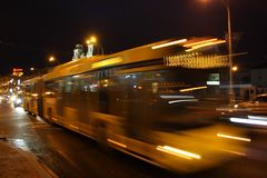 A blurred bus on the avenue in the evening. The motion of a blurred bus on the avenue in the evening stock photos