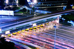 Blurred bus light trails in downtown night-scape Royalty Free Stock Photo