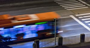 Blurred bus moves on street at night. Blurred bus moves on city street at night Royalty Free Stock Images
