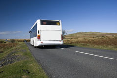 Blurred bus on rural road. Dartmoor, Devon, UK Royalty Free Stock Photos