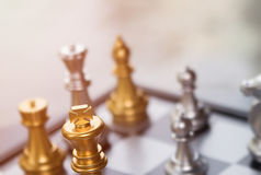 Blurred business competition concept with only the king in focus Royalty Free Stock Photos