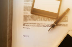 Blurred business letter document with pen and blank area for tex Royalty Free Stock Photography