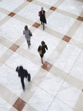 Blurred Business People Walking On Tiled Floor Stock Photography