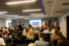 Blurred business seminar meeting in the conference hall. Defocused people royalty free stock photos