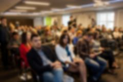 Blurred business seminar meeting in the conference hall. Defocused people stock photography