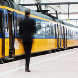 Blurred businessman at the station Stock Image