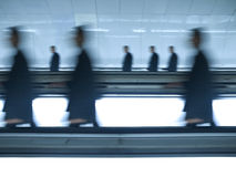 Blurred businessmen go to work stock image