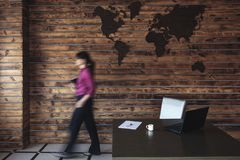 Blurred businesswoman walking to her desk royalty free stock photography