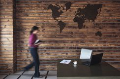 Blurred businesswoman walking to her desk stock image