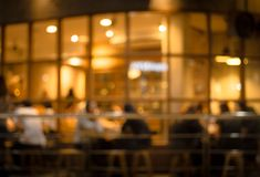 Blurred of cafe restaurant with light gold in night. Blurred of cafe  restaurant  with light gold in night.For modern lifestyle background Royalty Free Stock Photos