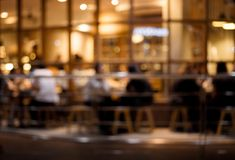 Blurred of cafe restaurant with light gold in night. Blurred of cafe  restaurant  with light gold in night.For modern lifestyle background Stock Images