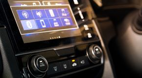 Blurred car audio and radio panel in modern car with flare light royalty free stock photo