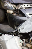 Blurred car crashed motorcycle. Top view of a motorcycle accident, which was hard hit by the car, which car park is blurred Royalty Free Stock Photos